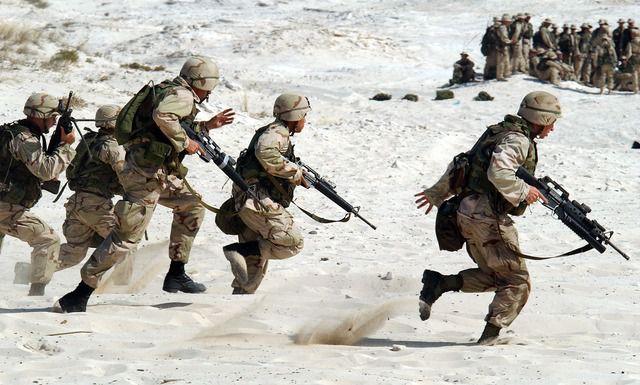 military running across the sand