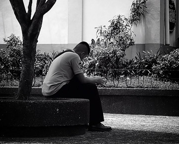 man sitting in front of a tree