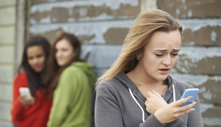 young girl staring at her phone hurt