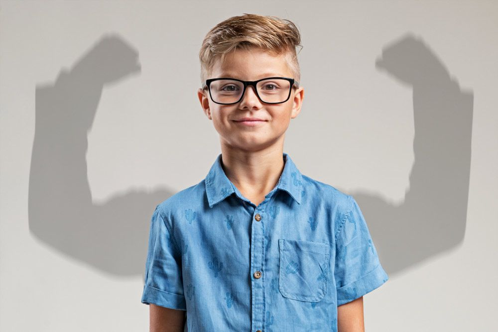 young boy with muscular arm shadow