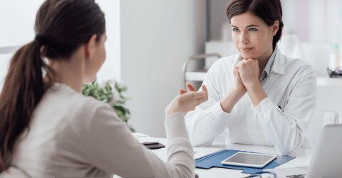 woman talking with psychologist