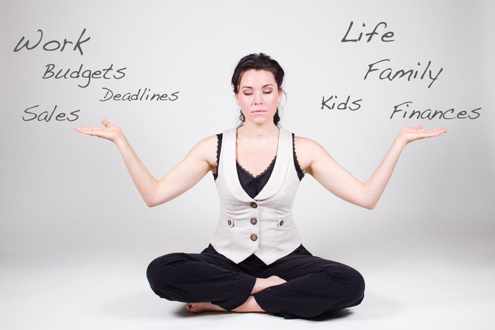 Woman sitting in a meditative state balancing various responsibilities
