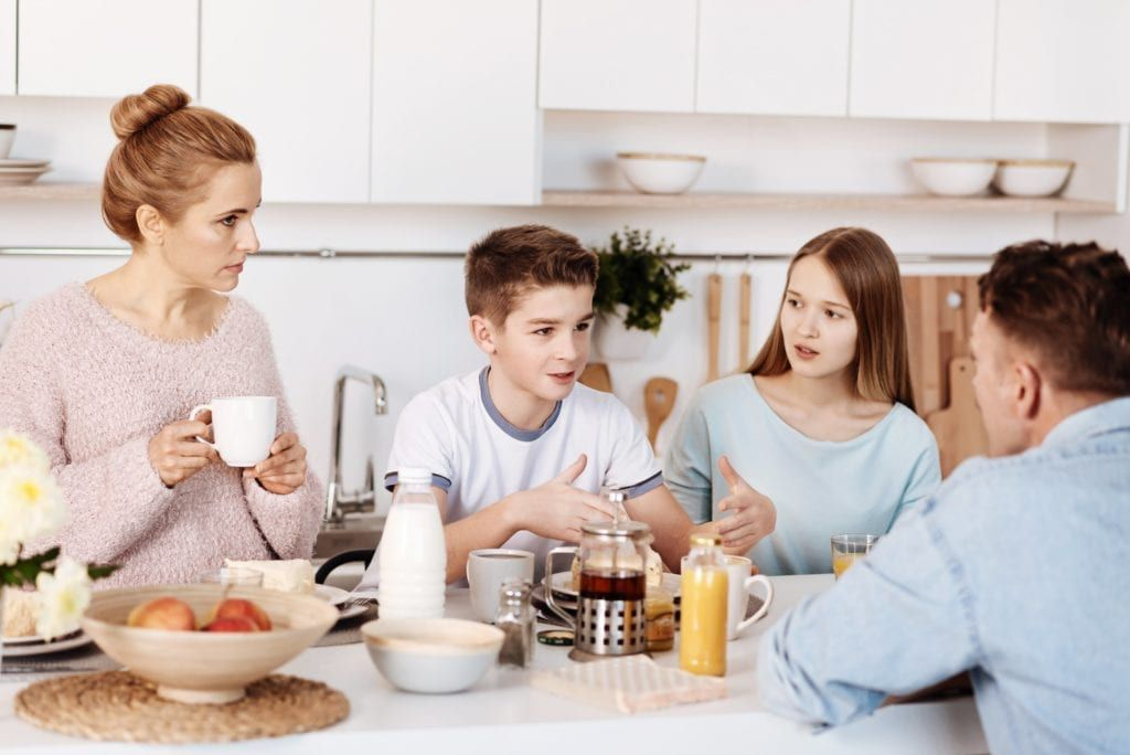 family communicating over a meal