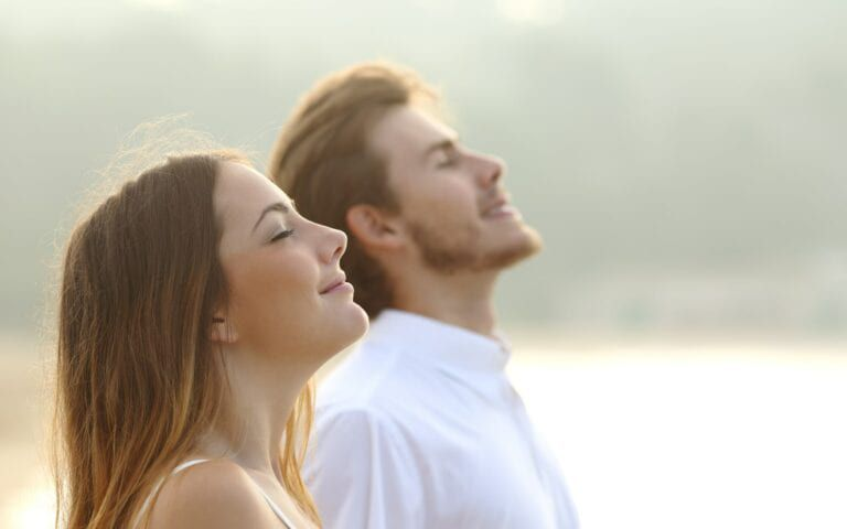 Two people basking and smiling