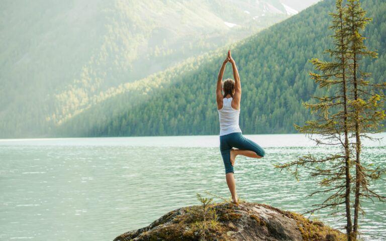 Woman meditating while doing yoga