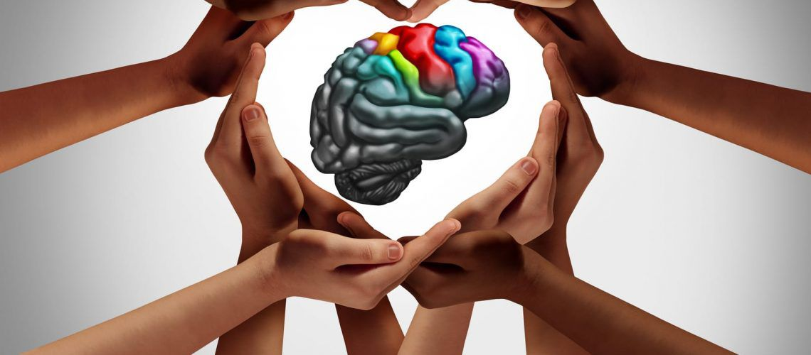 Autism brain in circle of hands