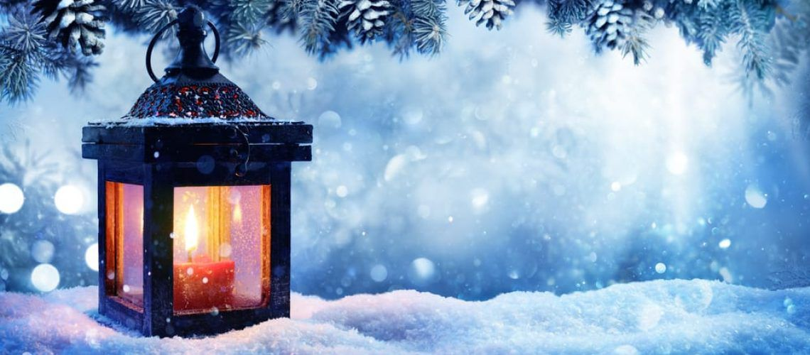 Warm candle in a cold winter night